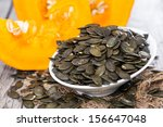 fresh roasted pumpkin seeds on... | Shutterstock . vector #156647048
