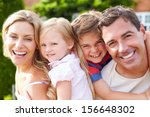 Portrait Of Happy Family In...