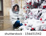 Happy girl with a Christmas tree - stock photo