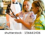 kids learning how to cook in a... | Shutterstock . vector #156661436