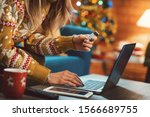 Woman Doing Online Shopping At...