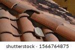 Broken Roof Tile In Need Of...