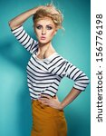 Stock photo colorful photo of a woman in white top and yellow skirt 156776198