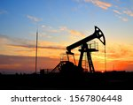 Small photo of Oil drilling derricks at desert oilfield for fossil fuels output and crude oil production from the ground. Oil drill rig and pump jack background, texture. Belarus, Rechitsa region