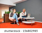 two colleagues discussing a... | Shutterstock . vector #156802985