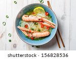 Closeup of Thai soup with scampi and noodles - stock photo