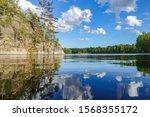 summer lake. water  wave  blue... | Shutterstock . vector #1568355172