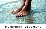 legs of a woman in the sea | Shutterstock . vector #156835946