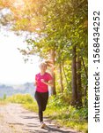Woman Jogging On A Country Road ...
