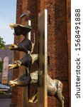Small photo of Riga, Riga/Latvia - 08.05.2019: The sculpture of Town Musicians of Bremen after St Peter's Church in Old Town of Riga. It shows the animals breaking through a wall, symbolic of the Iron Curtain.