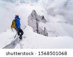 An Alpinist Climbing An Alpine...