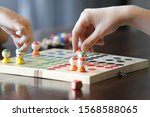 Board game with children hand ...