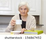 portrait of an elderly woman... | Shutterstock . vector #156867452