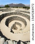 Small photo of Cantalloc Aqueduct in Nazca, spiral or circle aqueducts or wells, Peru, Inca architecture and culture
