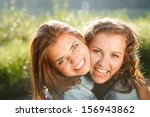 close up of two happy teenage... | Shutterstock . vector #156943862