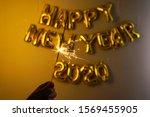 celebrating new year 2020 ...   Shutterstock . vector #1569455905