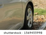 Side view of a parked car - stock photo