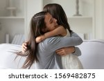 Small photo of Happy mother strong cuddles her little daughter, mom snuggle kid girl showing unconditional love and protection, miss each other concept of single mother sole custody, new loving mum for adopted child