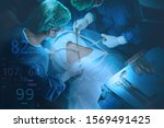 Small photo of Surgeons team holding medical instruments performing surgery with patient sleeping on operation bed in operation room at hospital. Medical and Healthcare concept.