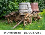 Old Wooden Cart With 3 Water...