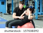 personal trainer helping young... | Shutterstock . vector #157038392