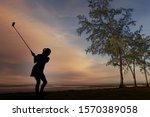 Silhouette Of A Female Golfer...