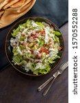 Small photo of Garden cobb salad with iceberg lettuce ham bacon and hardboiled eggs