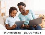 Black Mother Helping Daughter...