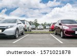 Cars Parked In Asphalt Parking...