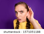 Small photo of Closeup photo of funny lady long braids holding arm near ear listening fresh rumours chatterbox person wear casual yellow jumper isolated purple color background