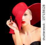 Beautiful Woman In Red Hat Wit...