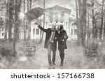 lovers under an umbrella | Shutterstock . vector #157166738