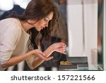 young woman looking at the shop ... | Shutterstock . vector #157221566