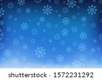 snowflakes on a blue background.... | Shutterstock .eps vector #1572231292