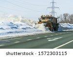 Snowplow Cleans The Highway...