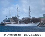 Small photo of Bergen, Norway - 13th April 2011: The Royal Norwegian Navy Training Barque the Statsraad Lenmukl, a 3 Masted Tallship moored up in blustery conditions.