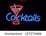 A Blue And Red Neon Sign...