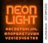 neon light alphabet font.... | Shutterstock .eps vector #1572891052