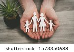 Hands Protecting A Family ...