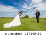 happy bride and groom playing... | Shutterstock . vector #157340492