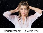 wet girl with serious face... | Shutterstock . vector #157345892