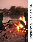 Bonfire At Sunset Africa...
