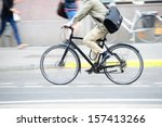 Man in suit on bike in profile - stock photo