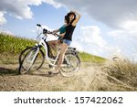 woman riding bicycle   Shutterstock . vector #157422062