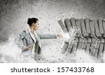 image of businesswoman breaking ... | Shutterstock . vector #157433768