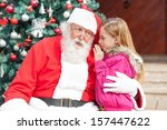 Girl Telling Wish In Santa...