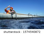 Small photo of An engineer controlling a quality of water ,aerated activated sludge tank at a waste water treatment plant. pollution