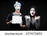 couple funny mimes holding sign | Shutterstock . vector #157472852
