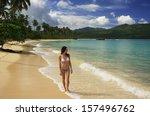 Young Woman In Bikini Walking...