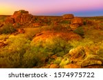 Small photo of Aerial view of amazing natural landscapes whit light sun and their deep red color of Devils Marbles. These gigantic boulders have become a symbol of Australia's outback, Northern Territory, Australia.